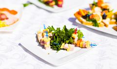 Fingerfood on appetizer table - stock photo