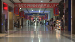 Dark poorly lit shopping mall in ghost city Ordos in China Stock Footage