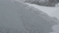 Slow motion windshield wipers cleaning snow off the car Stock Footage