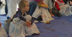 Kids Sit on a Floor Painting Gallery of Modern Art People in Aprons Paint in Stock Footage