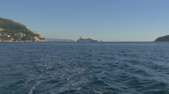 Ship navigating on the sea, Srdj Mountain and buildings on the shore, Dubrovnik Stock Footage
