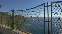 Beautiful view of love locks on a fence and the Adriatic Sea in Dubrovnik - stock footage