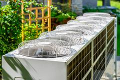 Air conditioning system assembled on side of a building Stock Photos