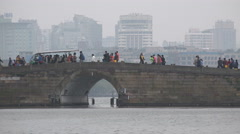China tourism, ancient stone bridge, contrast with modern Hangzhou city skyline Stock Footage