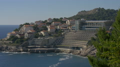 Houses and Hotel Rixos Libertas on Dubrovnik's cliffs, Croatia Stock Footage