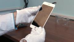 Repairman check chracked smartphone display - stock footage