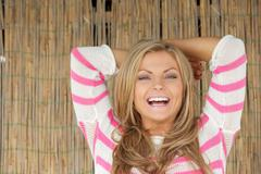 Close-up portrait of a beautiful woman smiling outdoors - stock photo