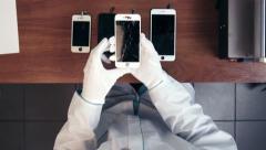 Repairman verify cracked smartphone display - stock footage