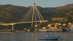 White boat moored close to Franjo Tudjman Bridge in Dubrovnik, Croatia Stock Footage