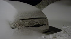 A car is buried under a snow bank caused by a massive winter blizzard Stock Footage