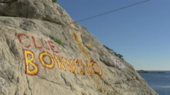 A club name painted on a cliff in Dubrovnik, Croatia Stock Footage