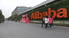China service industry, Alibaba company headquarters, employees walk over campus Stock Footage
