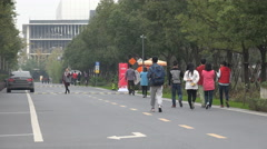 Chinese workers of Alibaba walk across campus at Hangzhou headquarter office Stock Footage
