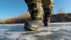 Foot steps on ice Stock Footage