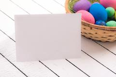 Colorful ecological styrofoam Easter eggs and blank white sheet of wood - stock photo