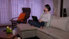 Young Asian Woman With Laptop Computer Telephone Phone On Sofa - stock footage