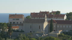View of a church with rosette and belfry in Dubrovnik, Croatia - stock footage
