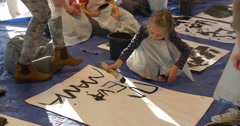 Family Master Class Art Gallery Opole Kids Writing Words on a Paper Painting Stock Footage