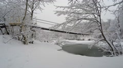 Dolly shot of bridge covered with snow - stock footage