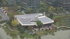 Technology startup campus, solar panels on rooftop, renewable energy China - stock footage