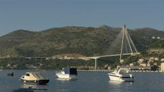 Four boats moored close to Franjo Tudjman Bridge, Dubrovnik, Croatia Stock Footage
