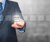 Business man Hand pressing virtual mail button - stock photo