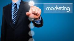 Businessman in dark suit pushing button - stock photo