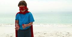 Boy pretending to be a superhero Stock Footage