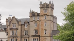 Cameron House Scottish Castle pan up wide shot Stock Footage