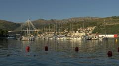 View of boats moored close to Franjo Tudjman Bridge in Dubrovnik, Croatia Stock Footage