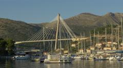 View of boats close to Franjo Tudjman Bridge in Dubrovnik, Croatia Stock Footage
