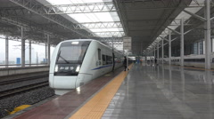 Chinese bullet train waiting at Wenzhou station platform Stock Footage