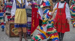 Two ladies in the national costume are holding a flag Stock Footage