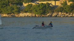 Inflatable boat and small sailing boats floating on the sea in Dubrovnik - stock footage