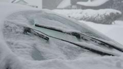 Slow motion car windshield wipers cleaning snow off. Stock Footage