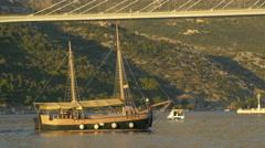 Ship sailing close to Franjo Tudjman bridge on a sunny day in Dubrovnik Stock Footage