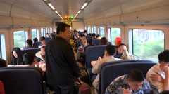 Busy dining car restaurant in a high speed bullet train in China Stock Footage
