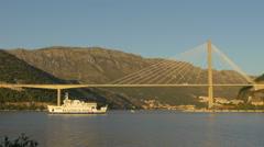 Jadrolinija boat sailing near Franjo Tudjman Bridge in Dubrovnik, Croatia Stock Footage