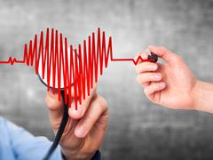 Closeup portrait doctor hand listening to heart beat in heart shape with stet Stock Photos