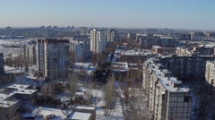 Flying over the snow-covered city aerial panel houses Eastern Europe. - stock footage