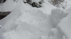 Slow motion shovelling snow in a drive way - Winter Storm Stock Footage