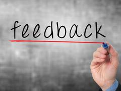 Feedback concept with businessman hand writing Stock Photos