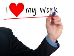Businessman writing I love my work with heart shape - stock photo