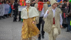 Different costumes in a parade Stock Footage