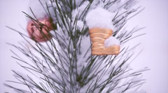 Christmas Decorations Hanging On A Snow-Covered Christmas Tree Stock Footage