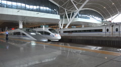 China modern high speed bullet train leaves station platform in Wuhan Stock Footage