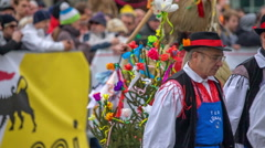 Men in national costumes and a kurent Stock Footage