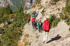 Group of trekkers on Annapurna circuit in Nepal. Stock Photos