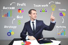Businessman draws a burning lamp. profitable business concept - stock photo