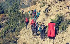 Group of trekkers on Annapurna circuit in Nepal. - stock photo